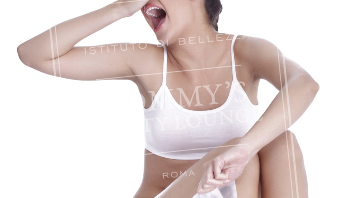 Expression woman depilating her legs